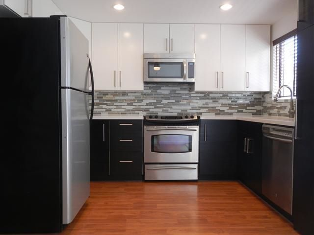 Newly remodeled with quartz countertops and stainless appliances