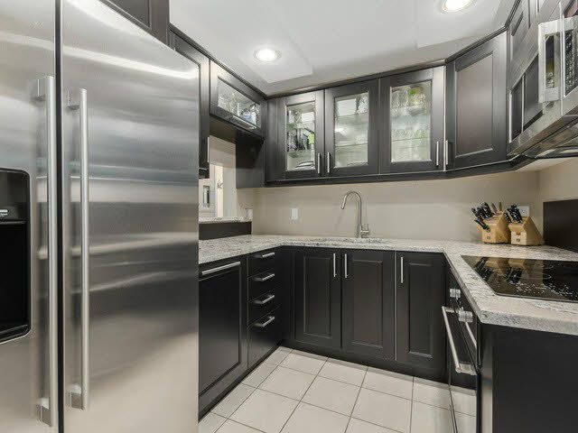 Main Photo: 201 1406 W 73RD Avenue in Vancouver: Marpole Condo for sale (Vancouver West)  : MLS®# V1111395
