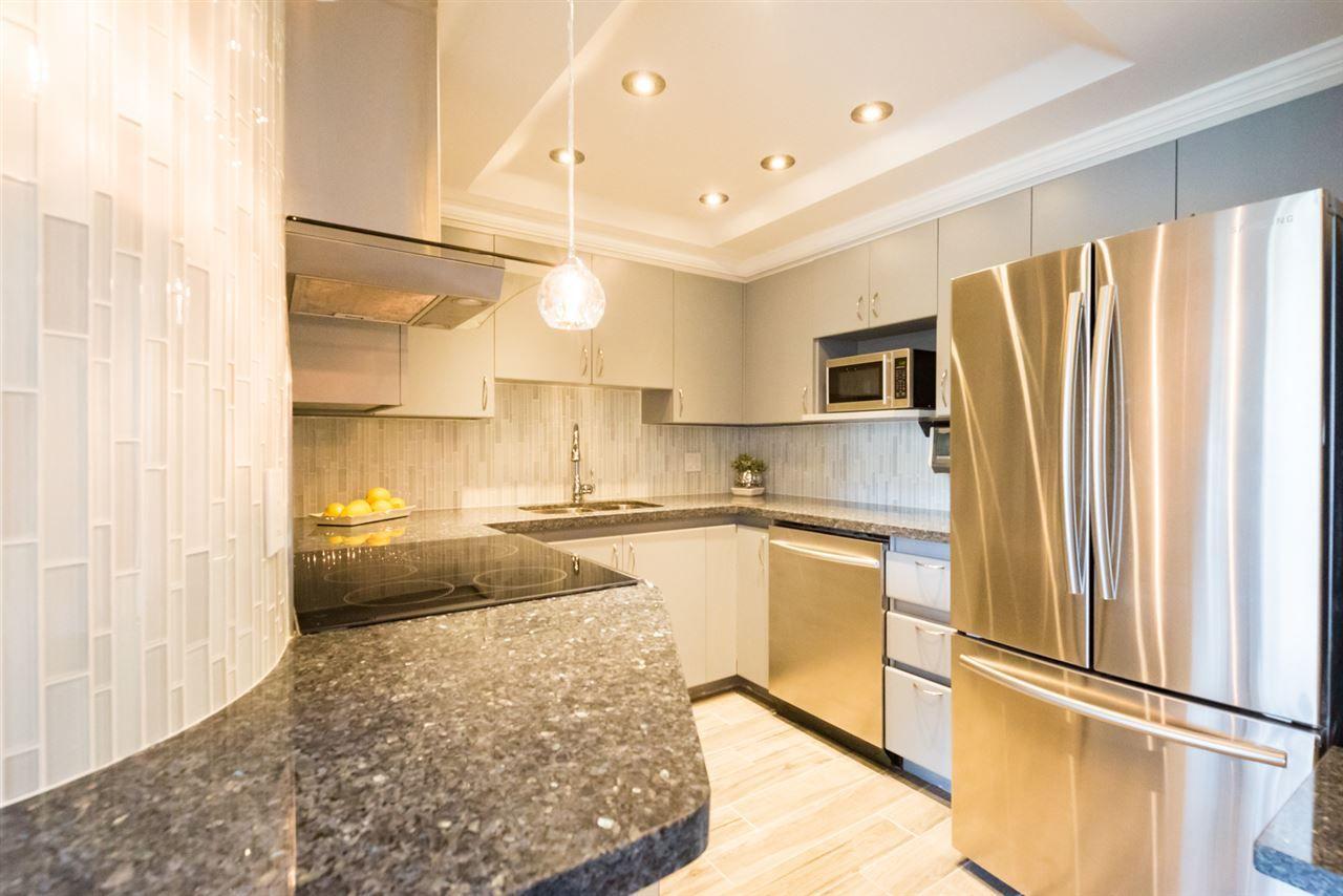 "Main Photo: 306 13353 108 Avenue in Surrey: Whalley Condo for sale in ""CORNERSTONE"" (North Surrey)  : MLS®# R2205440"