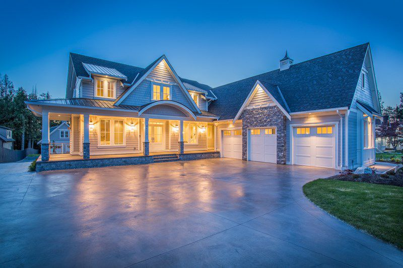 Gorgeous curb appeal with luxurious rock & lighting accents, grand roof line, exquisite landscaping, 3 car garage and stamped concrete driveway.