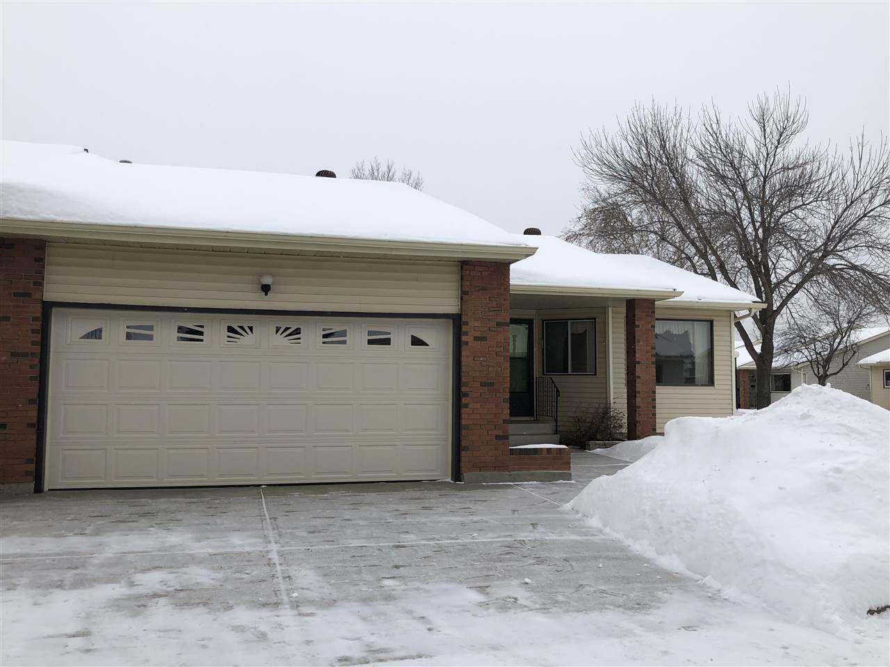 Main Photo: 10650 153 Avenue in Edmonton: Zone 27 House Half Duplex for sale : MLS®# E4141466