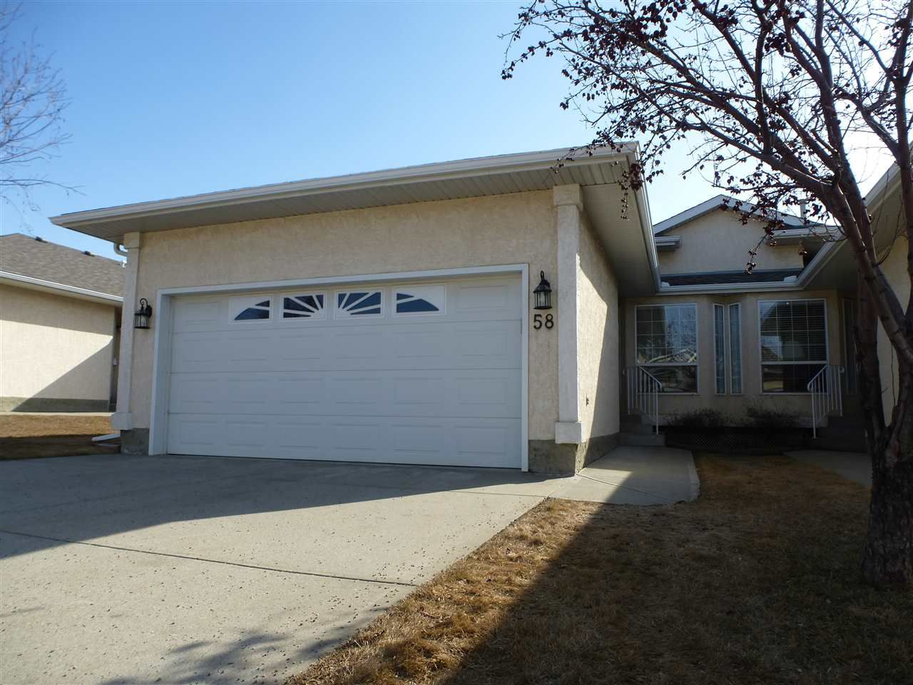 Main Photo: 58 14428 MILLER Boulevard NW in Edmonton: Zone 02 House Half Duplex for sale : MLS®# E4140792