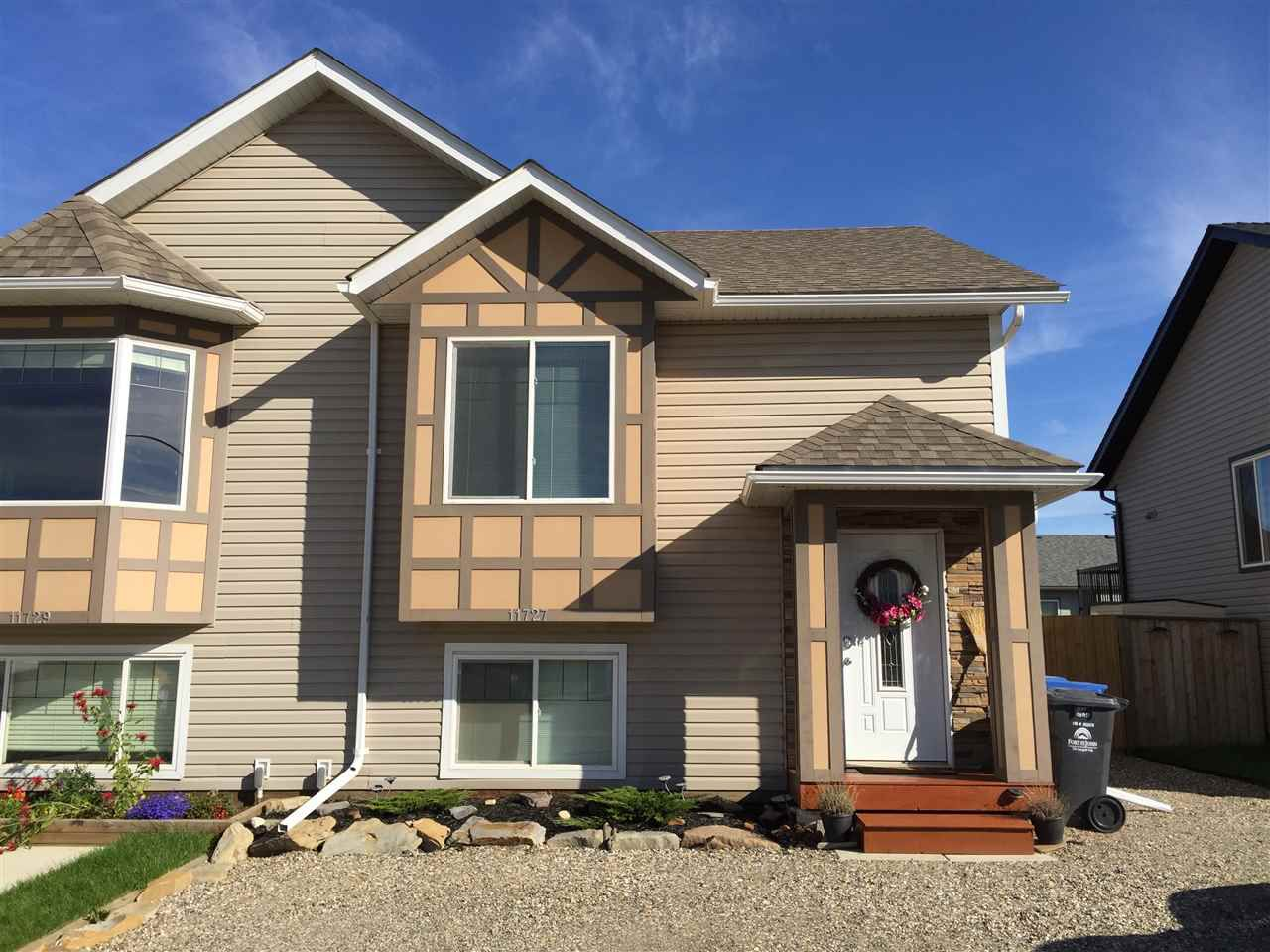 Main Photo: 11727 98A Street in Fort St. John: Fort St. John - City NE House 1/2 Duplex for sale (Fort St. John (Zone 60))  : MLS®# R2110876