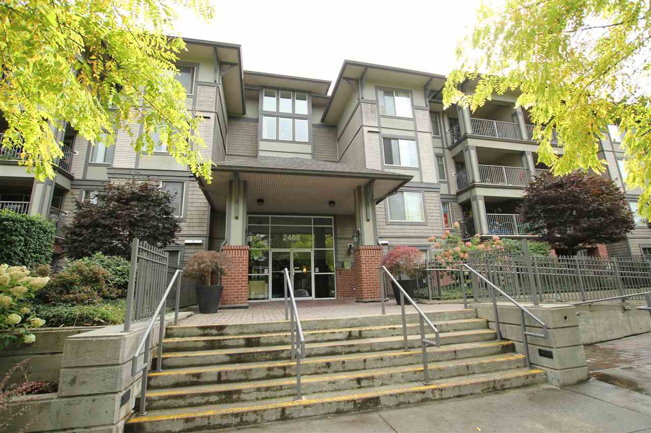 "Main Photo: 401 2468 ATKINS Avenue in Port Coquitlam: Central Pt Coquitlam Condo for sale in ""THE BORDEAUX"" : MLS®# R2000913"