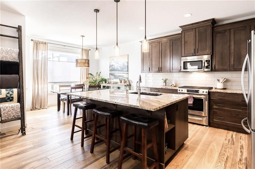 Main Photo: 1379 RAVENSCROFT Way SE: Airdrie House for sale : MLS®# C4166388