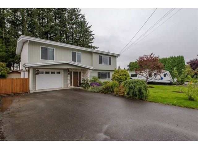 """Main Photo: 46498 BRICE Road in Chilliwack: Fairfield Island House for sale in """"FAIRFIELD ISLAND"""" : MLS®# R2330415"""
