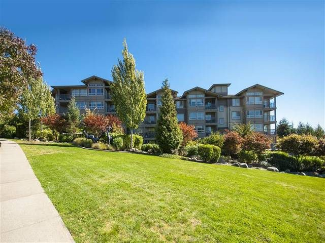 "Main Photo: 418 3110 DAYANEE SPRINGS BL in Coquitlam: Westwood Plateau Condo for sale in ""LEDGEVIEW"" : MLS®# R2118967"