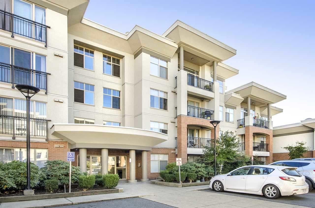 "Main Photo: 407 33545 RAINBOW Avenue in Abbotsford: Central Abbotsford Condo for sale in ""Tempo Luxury Apartment Units"" : MLS®# R2246948"