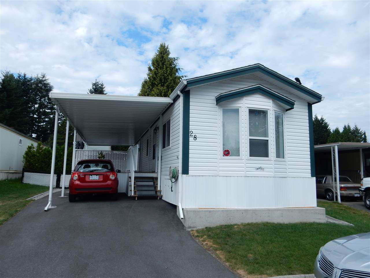 """Main Photo: 28 7790 KING GEORGE Boulevard in Surrey: East Newton Manufactured Home for sale in """"CRISPEN BAYS"""" : MLS®# R2099026"""