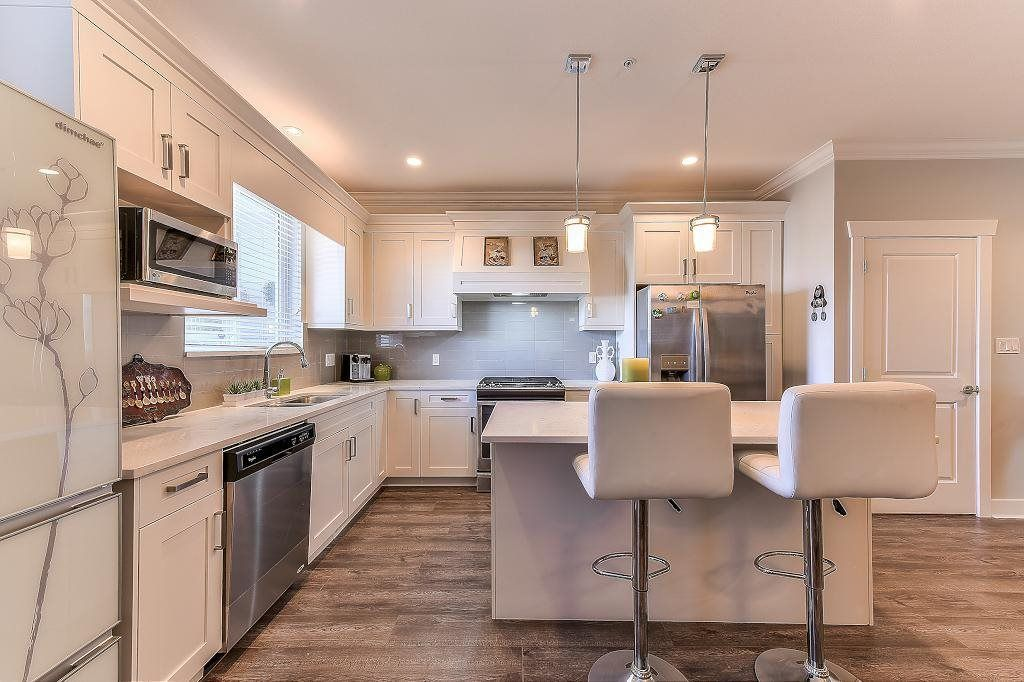 "Main Photo: 20937 80 Avenue in Langley: Willoughby Heights Condo for sale in ""AMBIANCE"" : MLS®# R2312450"