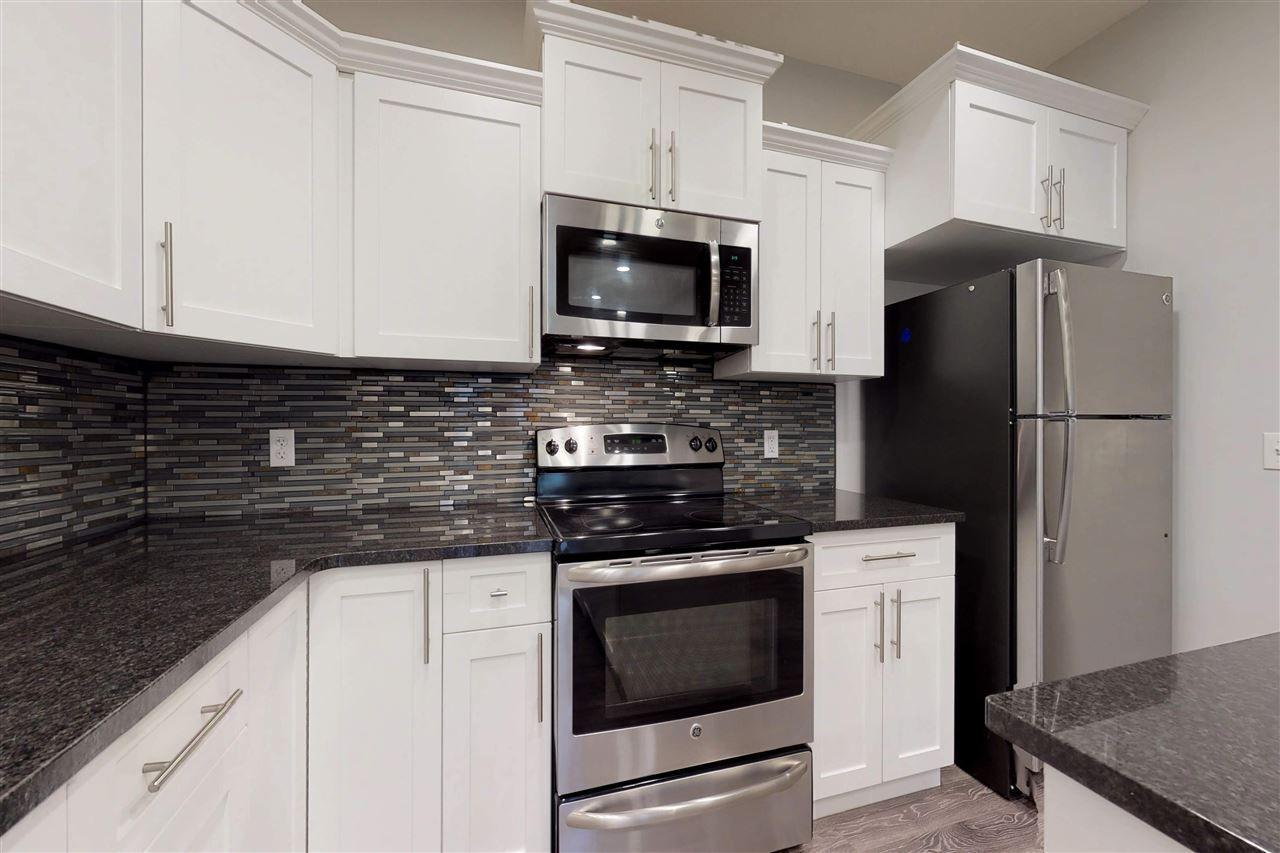 Main Photo: 337 WATT Boulevard in Edmonton: Zone 53 House Half Duplex for sale : MLS®# E4155277