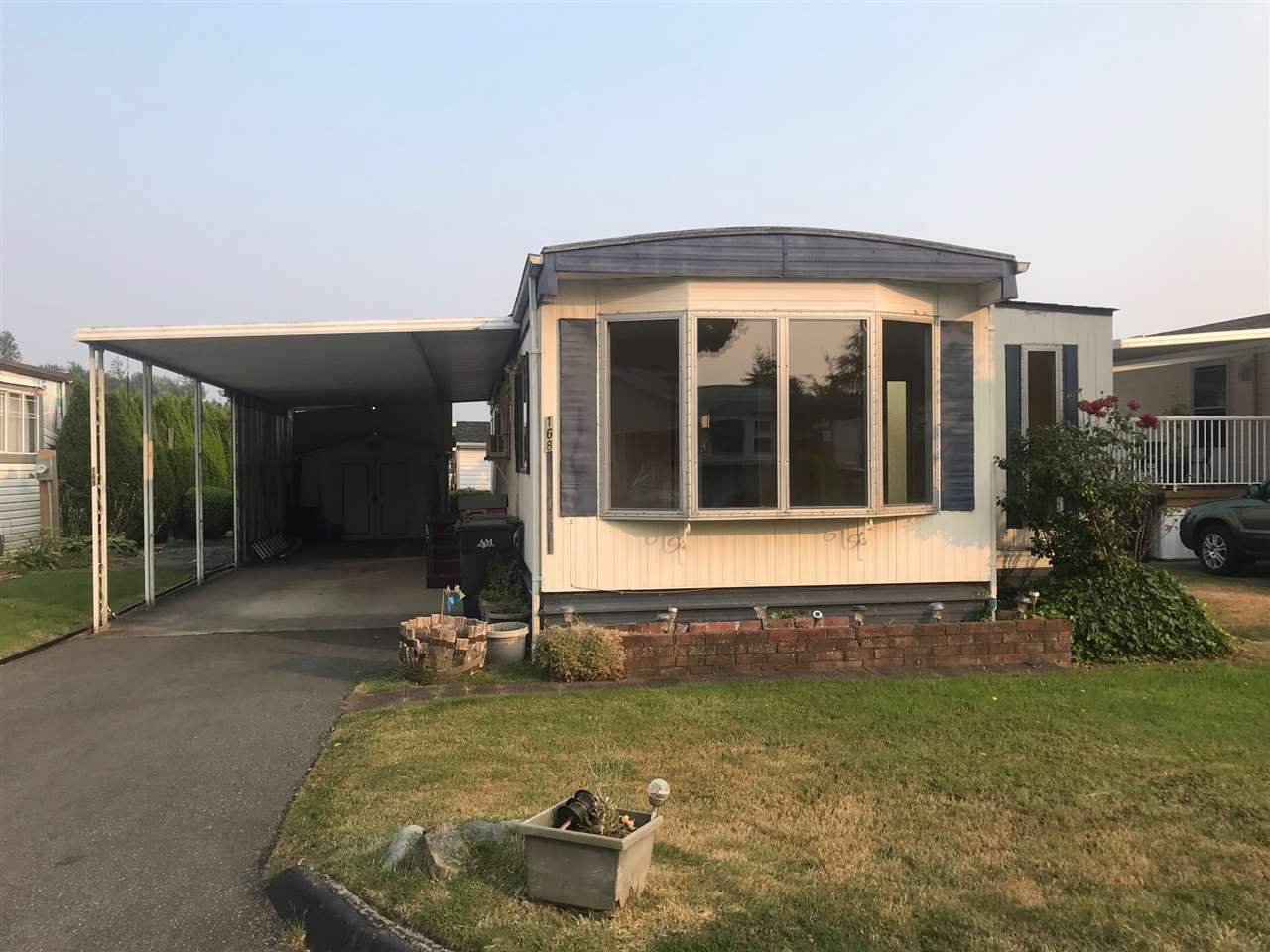 """Main Photo: 168 1840 160 Street in Surrey: King George Corridor Manufactured Home for sale in """"BREAKAWAY BAYS"""" (South Surrey White Rock)  : MLS®# R2297809"""