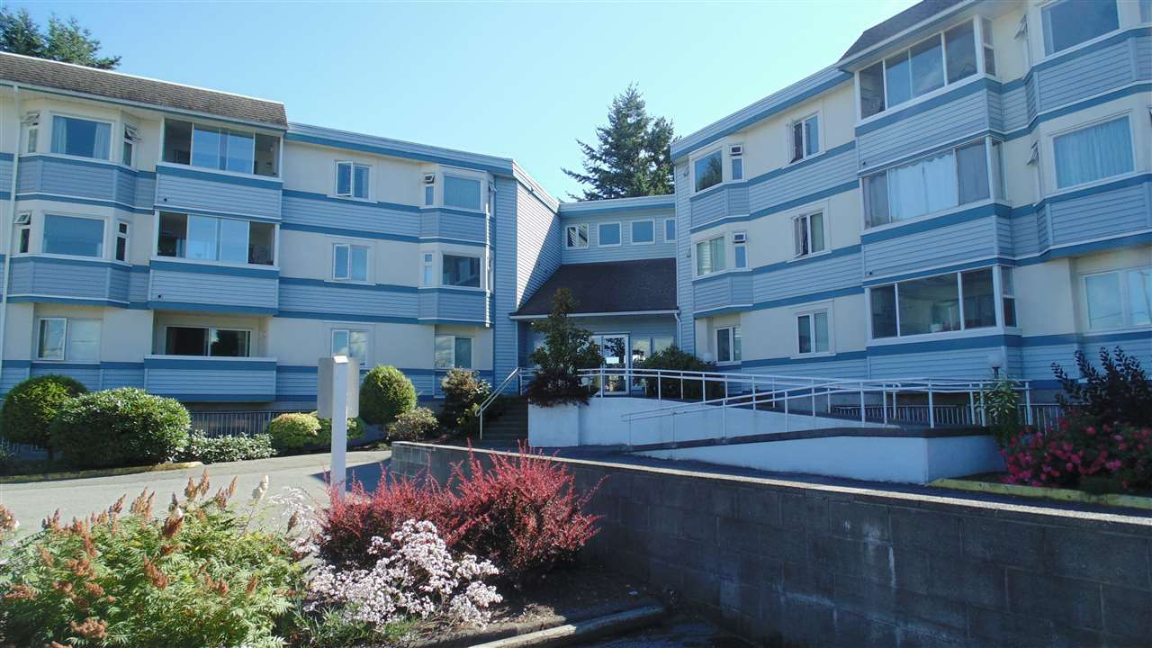 "Main Photo: 308 7175 134 Street in Surrey: West Newton Condo for sale in ""Sherwood Manor"" : MLS®# R2186794"