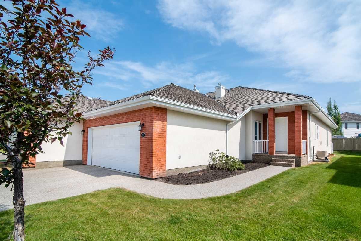Main Photo: 2 1225 Wanyandi Road in Edmonton: Zone 22 House Half Duplex for sale : MLS®# E4115355