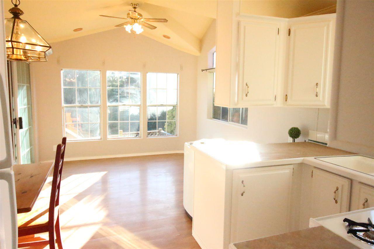 Vaulted ceilings, laminate flooring and WINDOWS!!