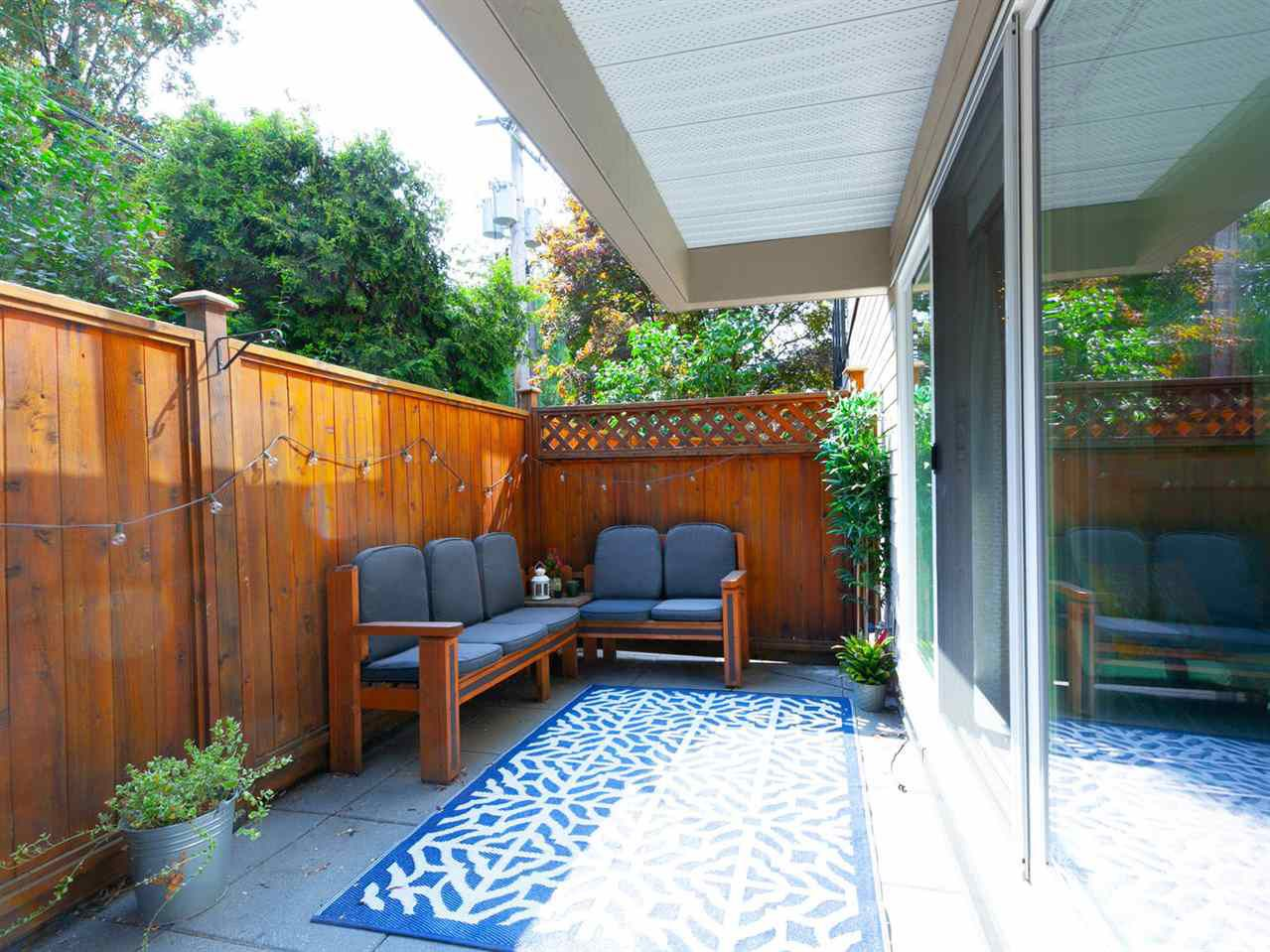 "Main Photo: 118 1440 E BROADWAY Avenue in Vancouver: Grandview VE Condo for sale in ""ALEXANDRA PLACE"" (Vancouver East)  : MLS®# R2300872"