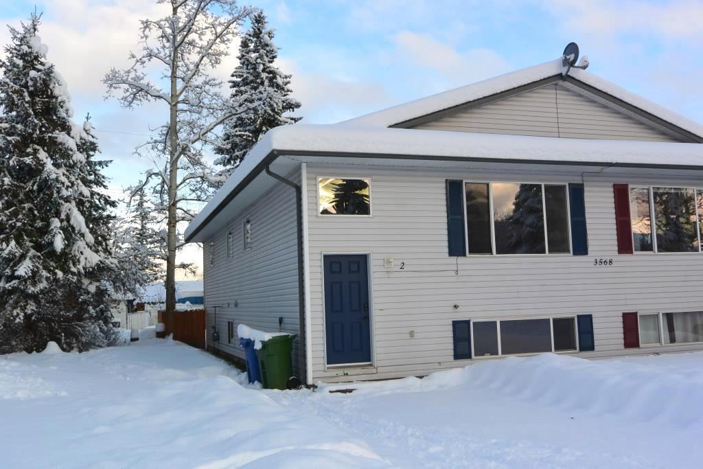 Main Photo: Unit A 3568 3rd Avenue Smithers | Half Duplex