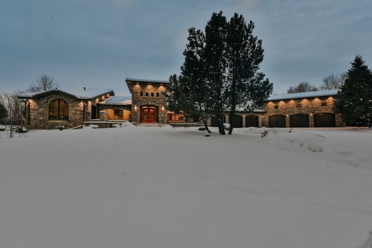 A touch of Tuscany. Architecturally designed to inspire. Nestle on 4.01 acres with 1 acre beautifully landscape. Stone exterior with wood detailing. 6 car attached garage!