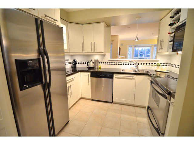 """Main Photo: 222 2545 W BROADWAY in Vancouver: Kitsilano Townhouse for sale in """"TRAFALGAR MEWS"""" (Vancouver West)  : MLS®# V1097981"""