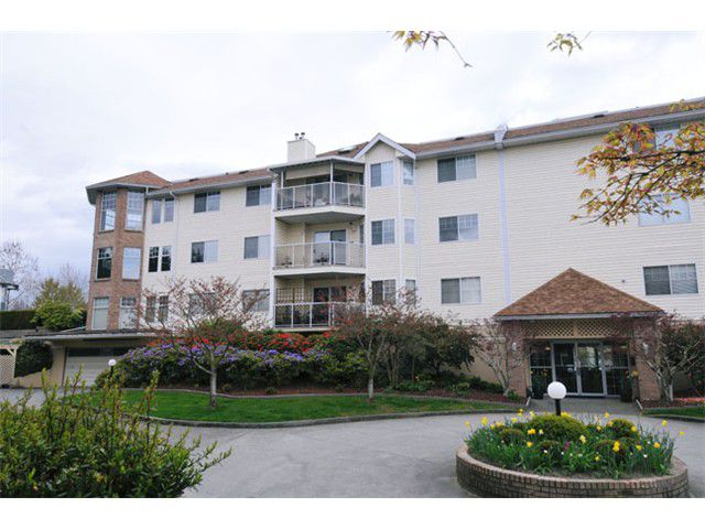 "Main Photo: 308 22611 116TH Avenue in Maple Ridge: East Central Condo for sale in ""ROSEWOOD COURT"" : MLS®# V1058553"