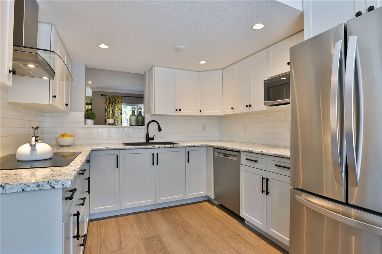 "Main Photo: 522 CARLSEN Place in Port Moody: North Shore Pt Moody Townhouse for sale in ""EAGLE POINT"" : MLS®# R2367273"