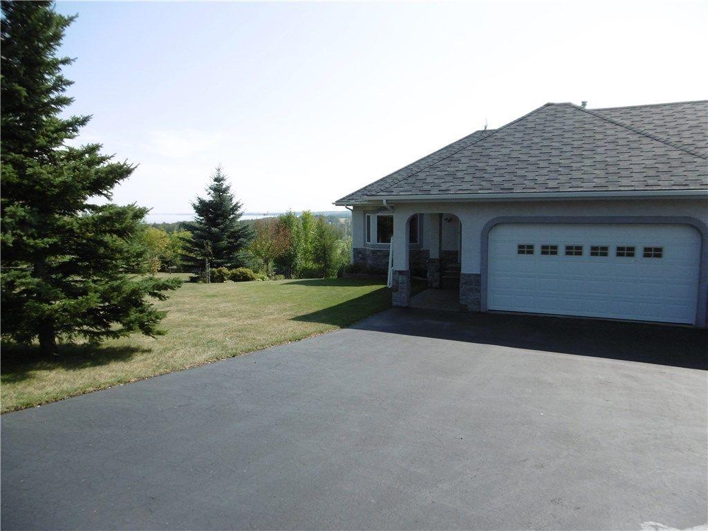 Main Photo: 15 420068 Highway 771 in Rural Ponoka County: Poulsen's Estates Residential Acreage for sale (Ponoka County)  : MLS®# CA0140672