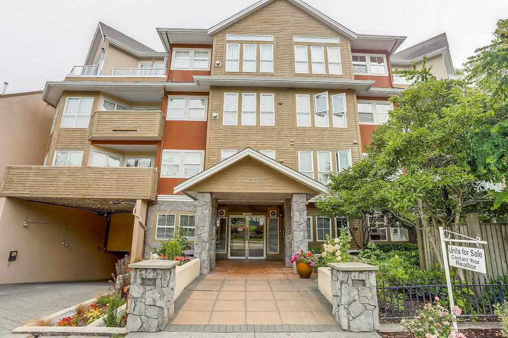 "Main Photo: 101 1630 154 Street in Surrey: King George Corridor Condo for sale in ""CARLTON COURT"" (South Surrey White Rock)  : MLS®# R2189691"