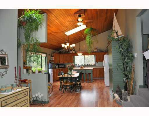 Spriggs has an open floor plan living, dining and kitchen with vaulted ceilings and skylights to bring the outdoor brightness in.