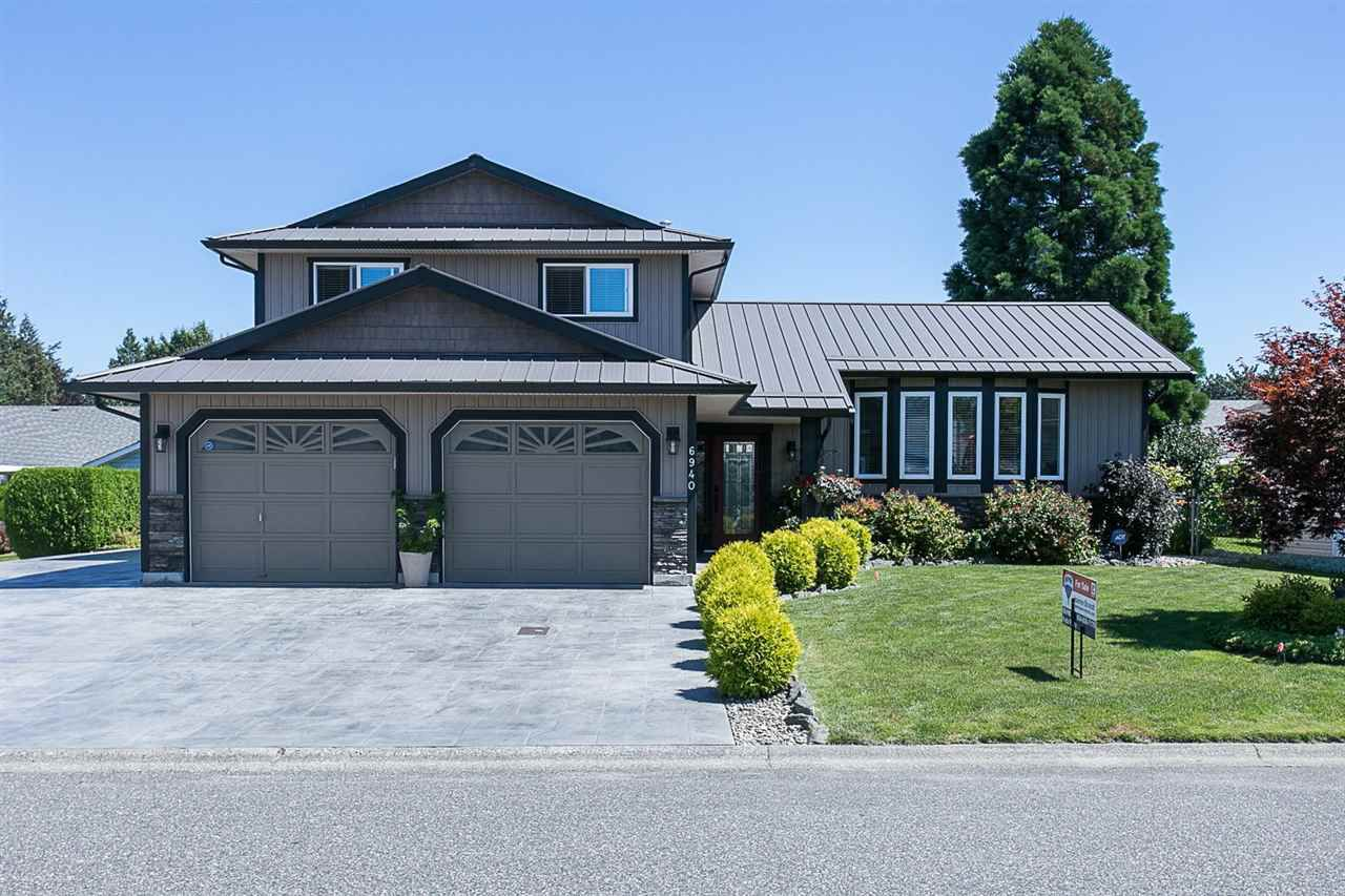 "Main Photo: 6940 COACH LAMP Drive in Chilliwack: Sardis West Vedder Rd House for sale in ""WELLS LANDING"" (Sardis)  : MLS®# R2093207"