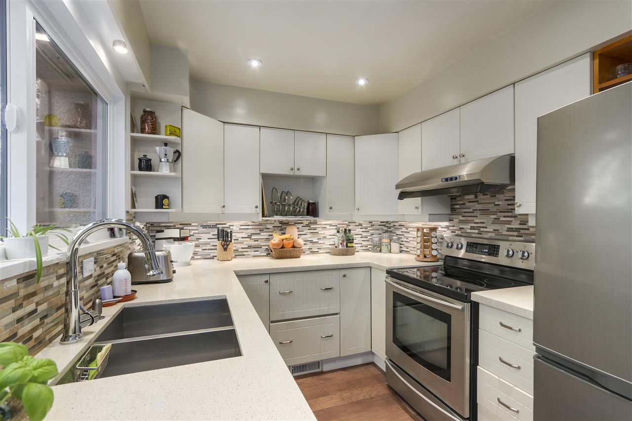 """Main Photo: 1031 OLD LILLOOET Road in North Vancouver: Lynnmour Townhouse for sale in """"LYNNMOUR WEST"""" : MLS®# R2375235"""