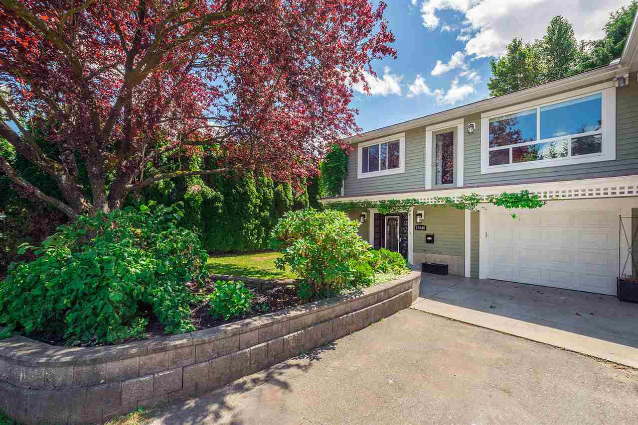 Main Photo: 12646 93A Avenue in Surrey: Queen Mary Park Surrey House 1/2 Duplex for sale : MLS®# R2181340