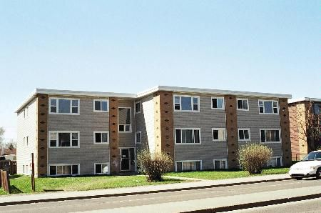Main Photo: 18 Suite Apartment Building