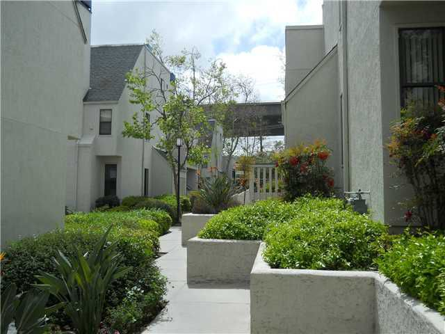 Main Photo: MISSION VALLEY Condo for sale : 2 bedrooms : 2210 River Run Drive #64 in San Diego