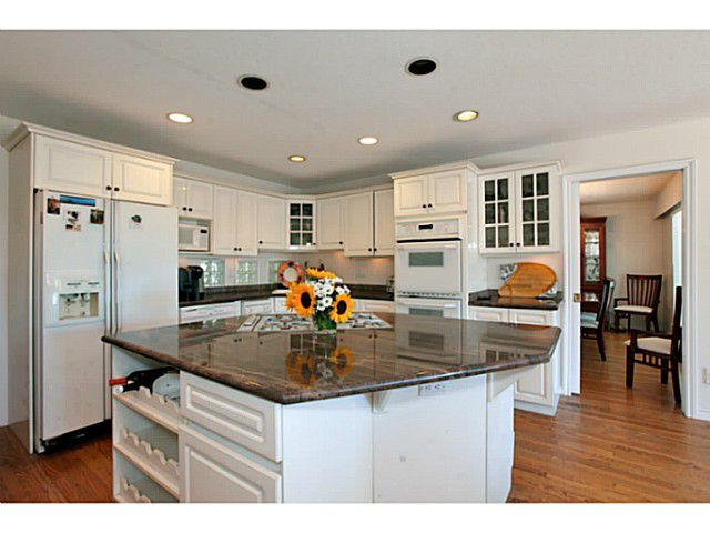 Bright white kitchen with double wall oven
