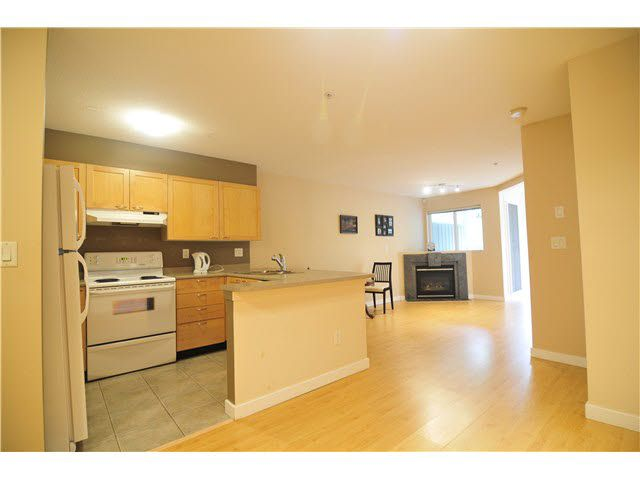 "Main Photo: 201 7383 GRIFFITHS Drive in Burnaby: Highgate Condo for sale in ""EIGHTEEN TREES"" (Burnaby South)  : MLS®# R2046692"