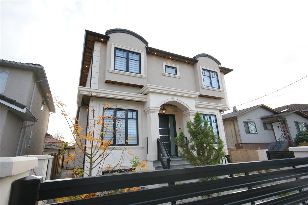 """Main Photo: 2136 E 34TH Avenue in Vancouver: Victoria VE House for sale in """"Victoria"""" (Vancouver East)  : MLS®# R2219667"""