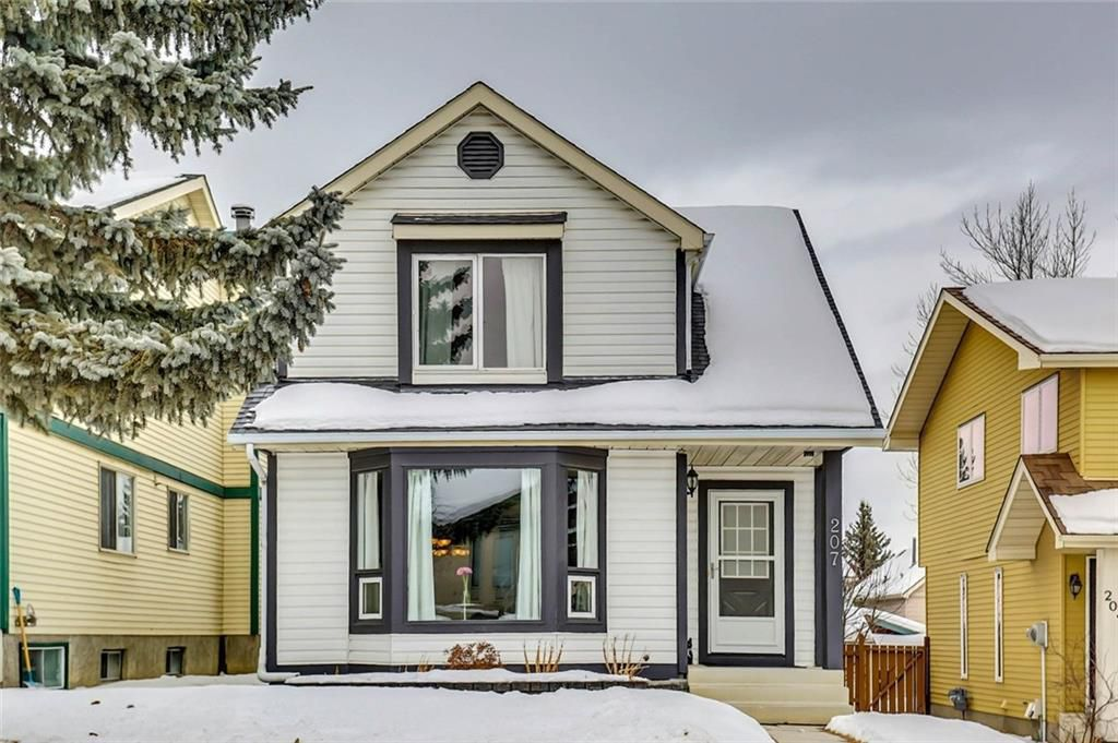 Main Photo: 207 STRATHEARN Crescent SW in Calgary: Strathcona Park House for sale : MLS®# C4165815