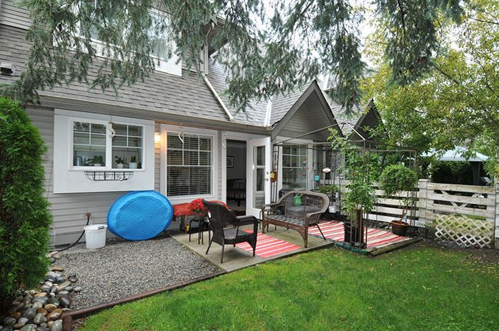 Private, fenced, west facing yard and patio, some nice garden area for the avid gardener!