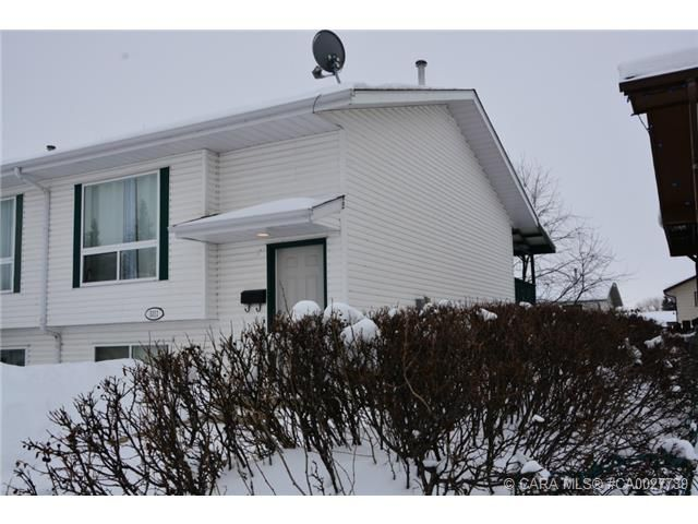 Main Photo: 5311 38 Street in Innisfail: IL Margodt Residential for sale : MLS®# CA0027739