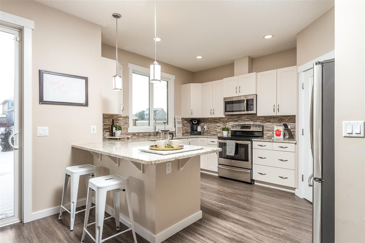 Main Photo: 13009 205 Street in Edmonton: Zone 59 House Half Duplex for sale : MLS®# E4139675