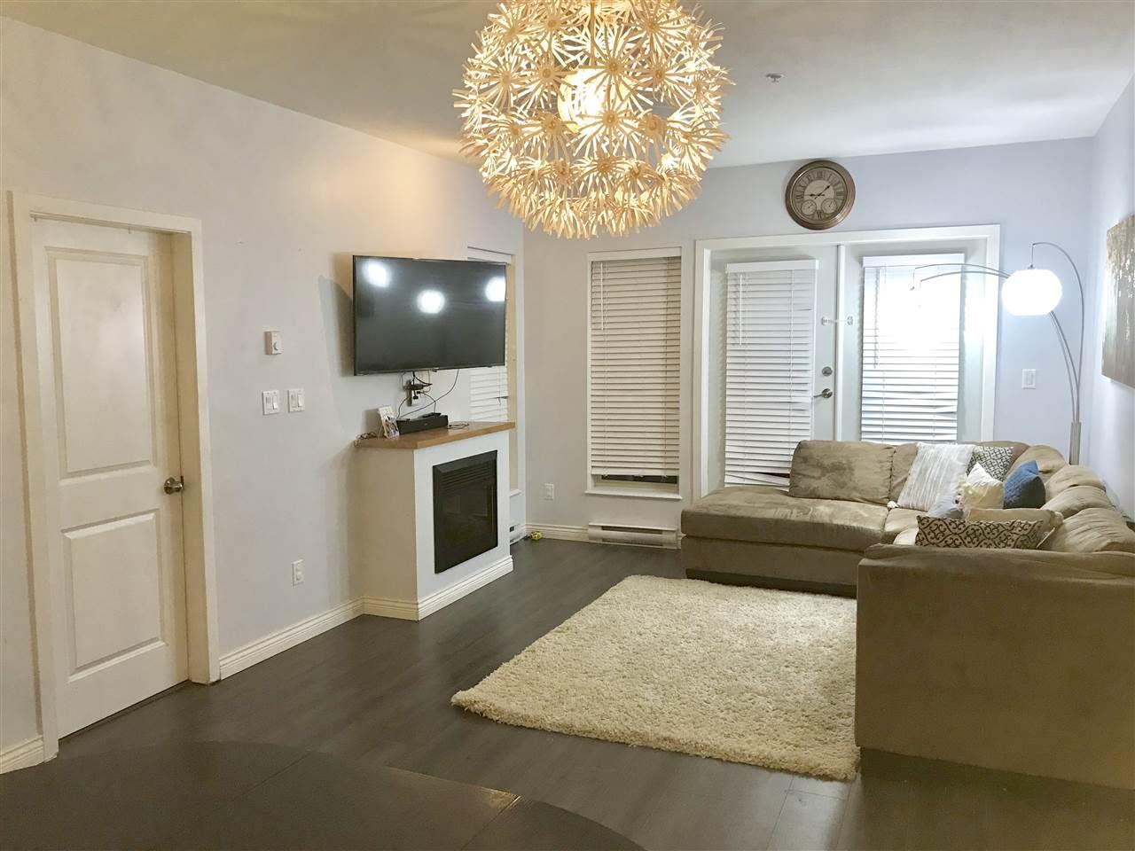 """Main Photo: 101 15322 101 Avenue in Surrey: Guildford Condo for sale in """"Ascada"""" (North Surrey)  : MLS®# R2331445"""