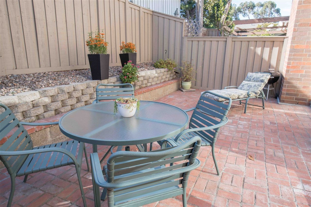 Sunny & spacious backyard with lovely low maintenance brick patio area.  Perfect for entertaining or relaxing.  This space is larger than many of the others in the neighborhood.