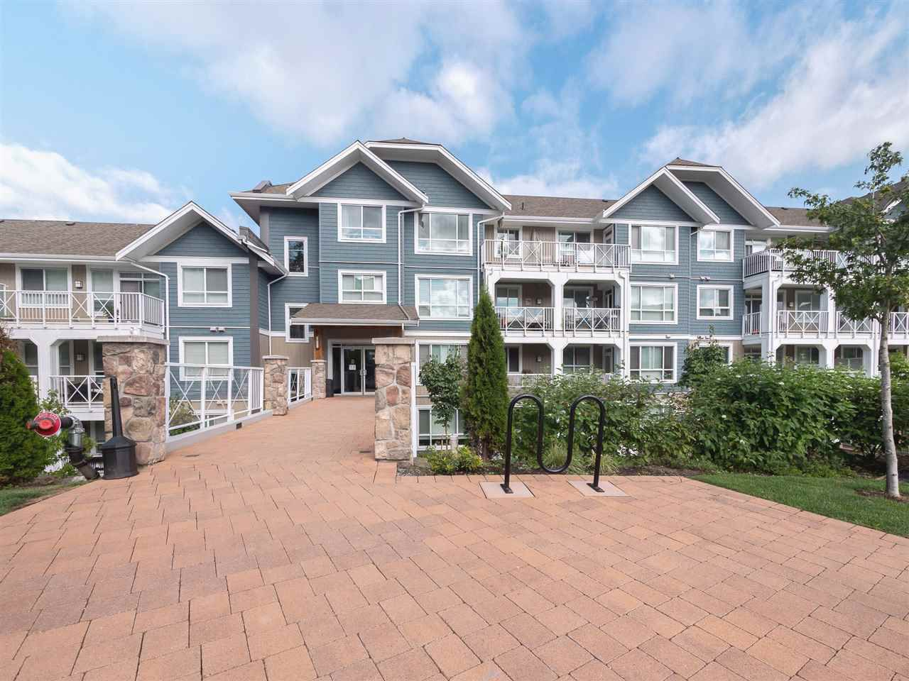 """Main Photo: 504 16380 64TH Avenue in Surrey: Cloverdale BC Condo for sale in """"THE RIDGE AT BOSE FARMS"""" (Cloverdale)  : MLS®# R2346721"""
