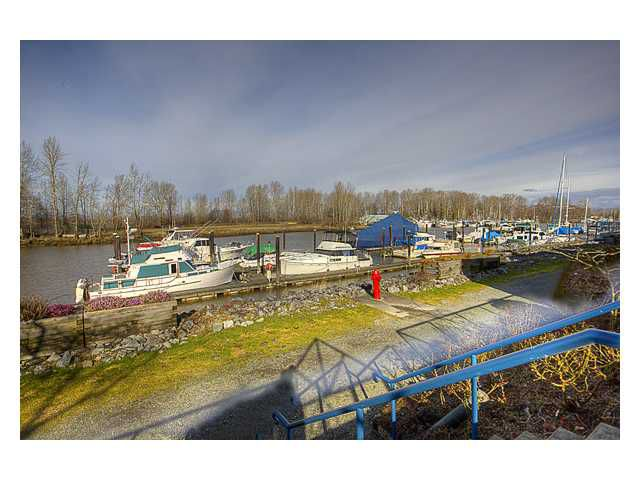 "Main Photo: 106 4733 W RIVER Road in Ladner: Ladner Elementary Condo for sale in ""RIVER WEST"" : MLS®# V869103"