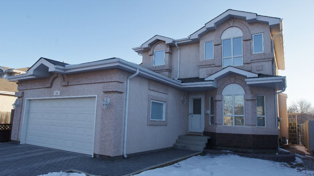 Maintenance free exterior with over sized double garage & interlock walk & driveway.