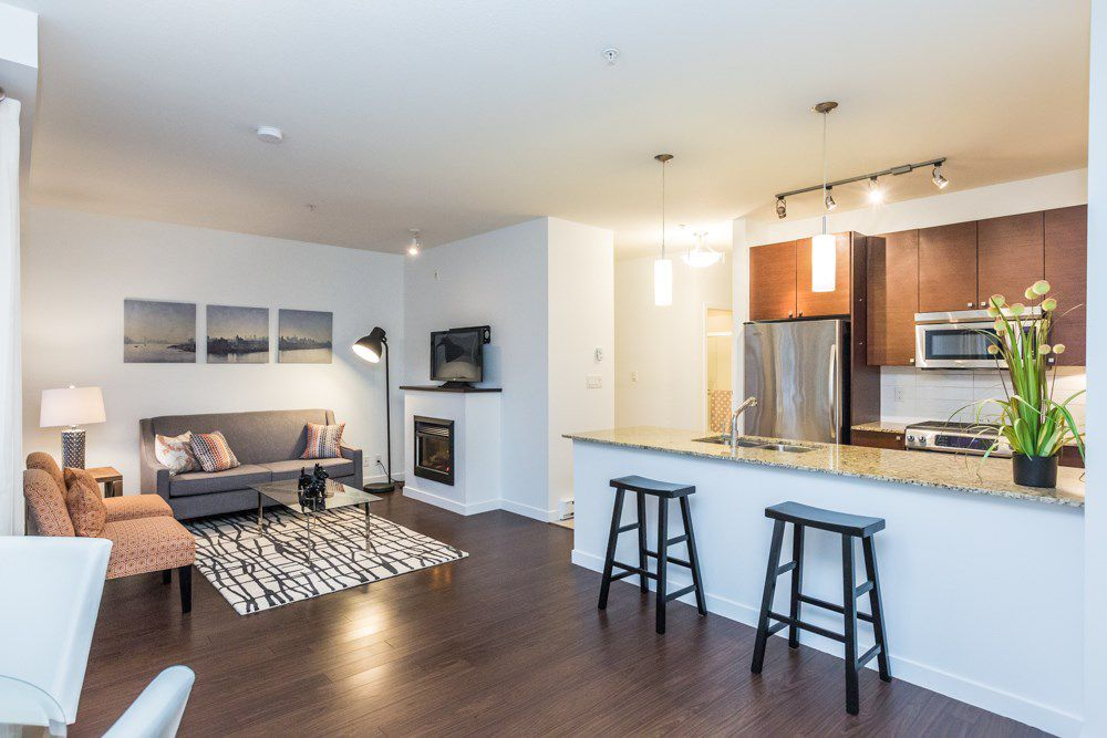 Main Photo: 109 101 MORRISSEY ROAD in Port Moody: Port Moody Centre Condo for sale : MLS®# R2138128