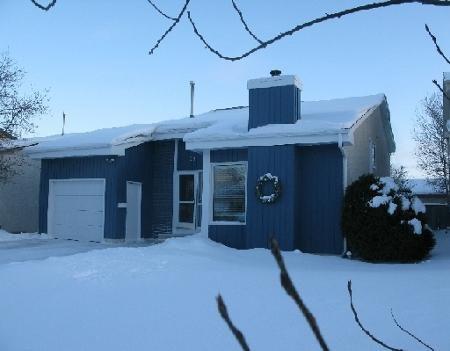 Main Photo: Spacious home with new windows!