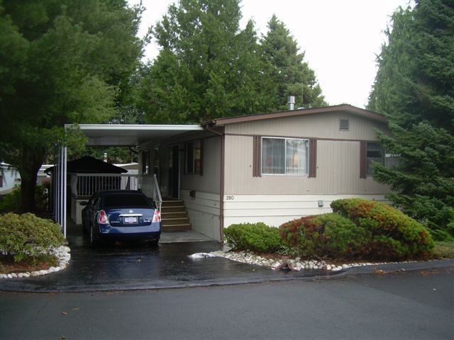 """Main Photo: 280 1840 160TH Street in Surrey: King George Corridor Manufactured Home for sale in """"BREAKAWAY BAYS"""" (South Surrey White Rock)  : MLS®# F1228264"""