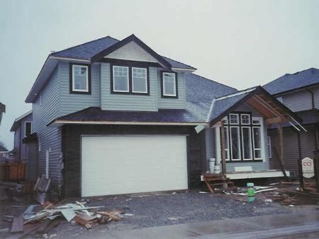 Main Photo: New Traditional Plan With 2 Storey Vaulted Ceiling