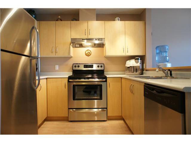 """Main Photo: 306 3038 E KENT Avenue in Vancouver: Fraserview VE Condo for sale in """"SOUTH HAMPTON"""" (Vancouver East)  : MLS®# V954697"""